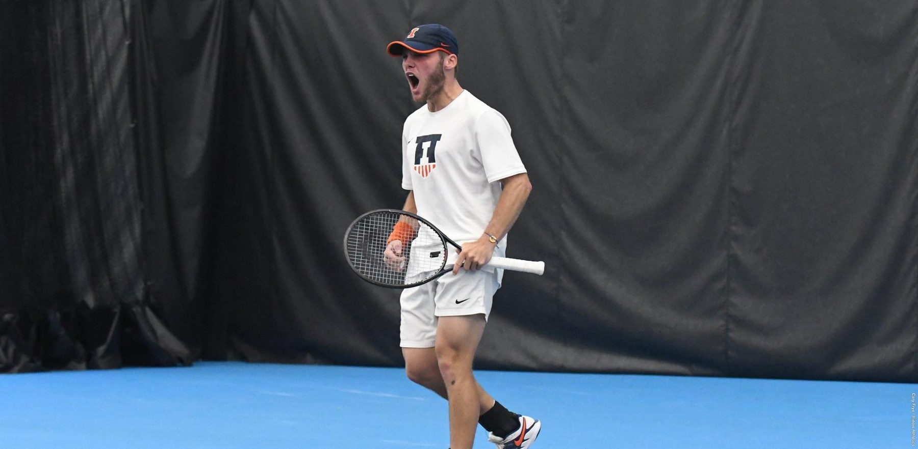 Illini tennis player shouts during a match