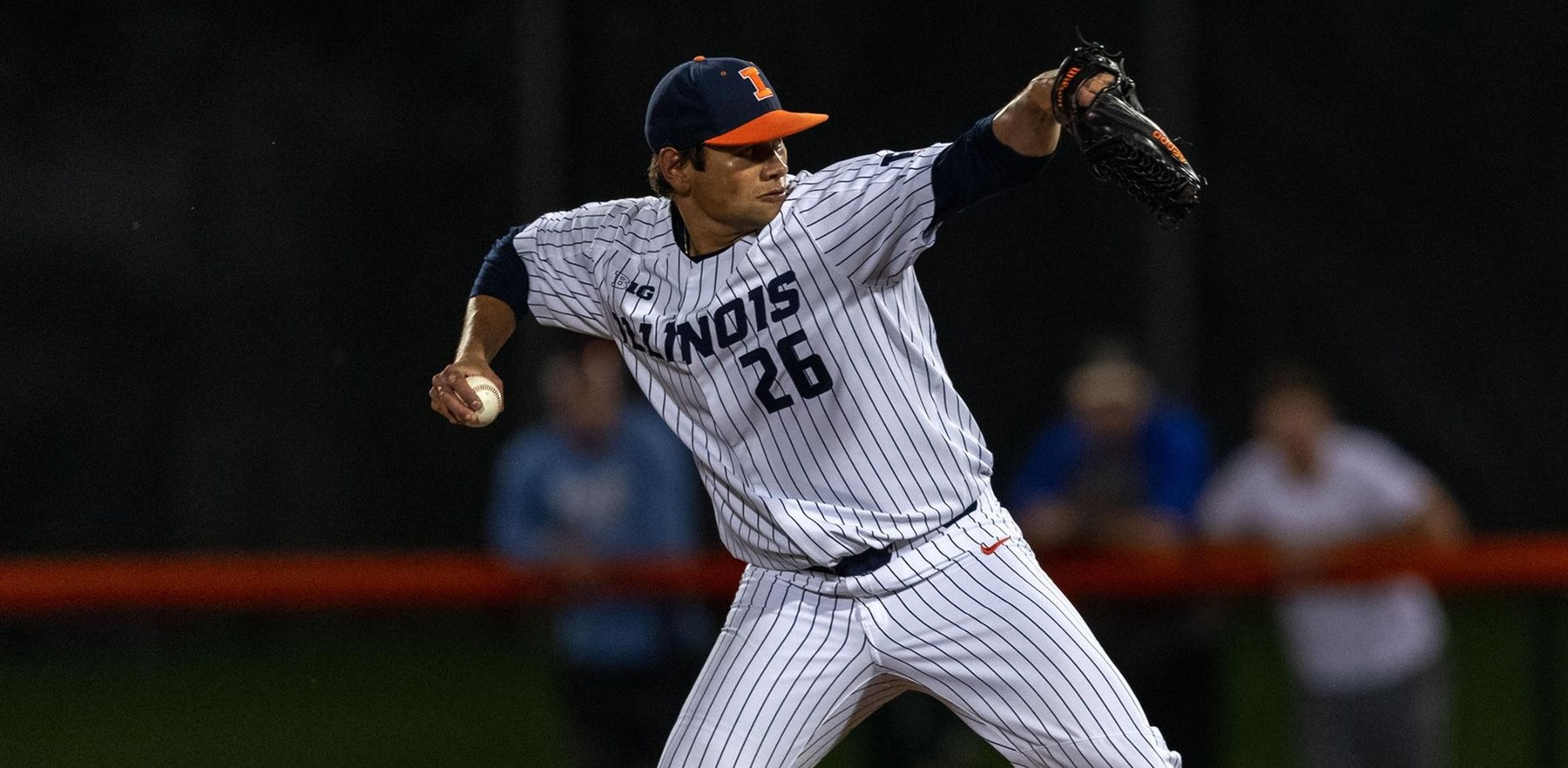 junior Illini pitcher Garrett Acton in action
