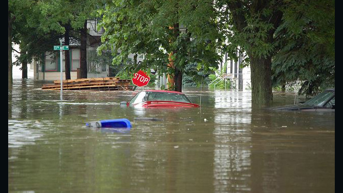 Flooded street with homes and cars. Photo by U.S. Geological Survey