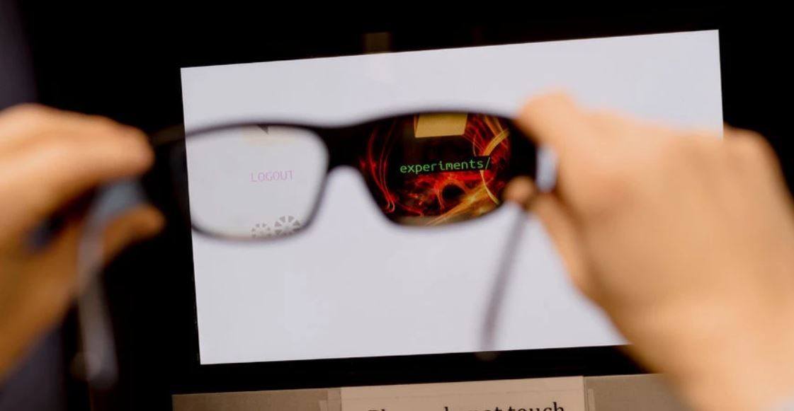 Glasses reveal secret messages on a monitor in Lab Escape.CreditLyndon French for The New York Times