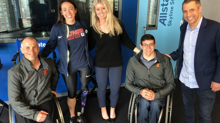 Athletes in wheelchairs with WGN staff