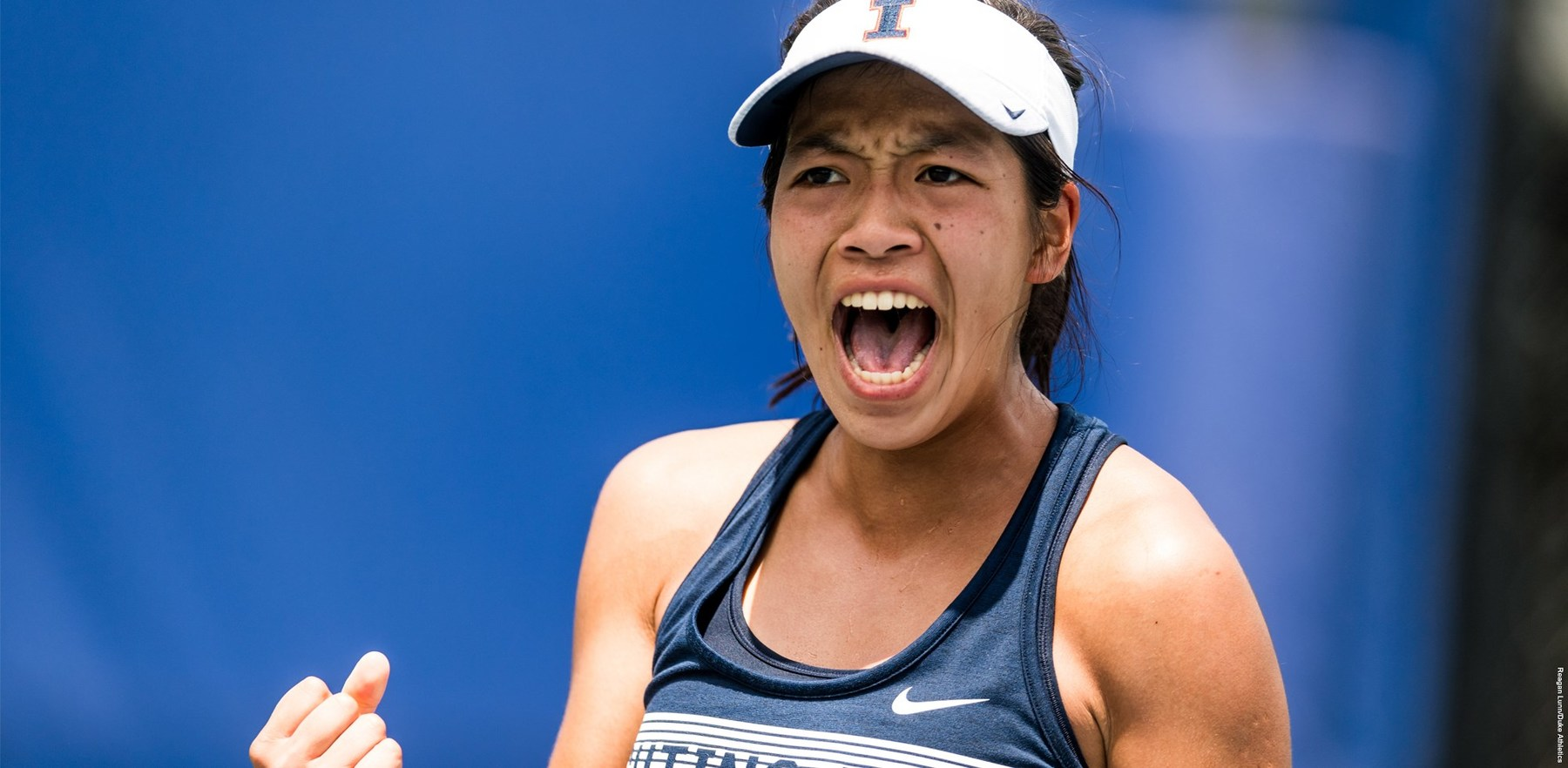 Women's tennis star Asuka Kawai shouts in celebration during a match