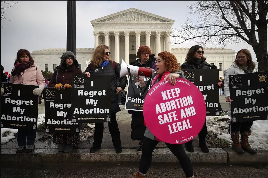Protesters on both sides of the abortion issue gather in front of the U.S. Supreme Court building during the Right To Life March in January, 2019 in Washington, DC. Mark Wilson/Getty Images