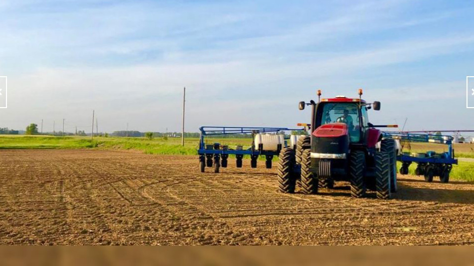 Indiana farmer prepares a field for planting when it was dry enough for a minute