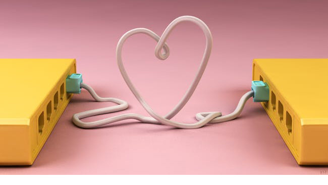 two hard drives connected by a cord that forms a heart shape