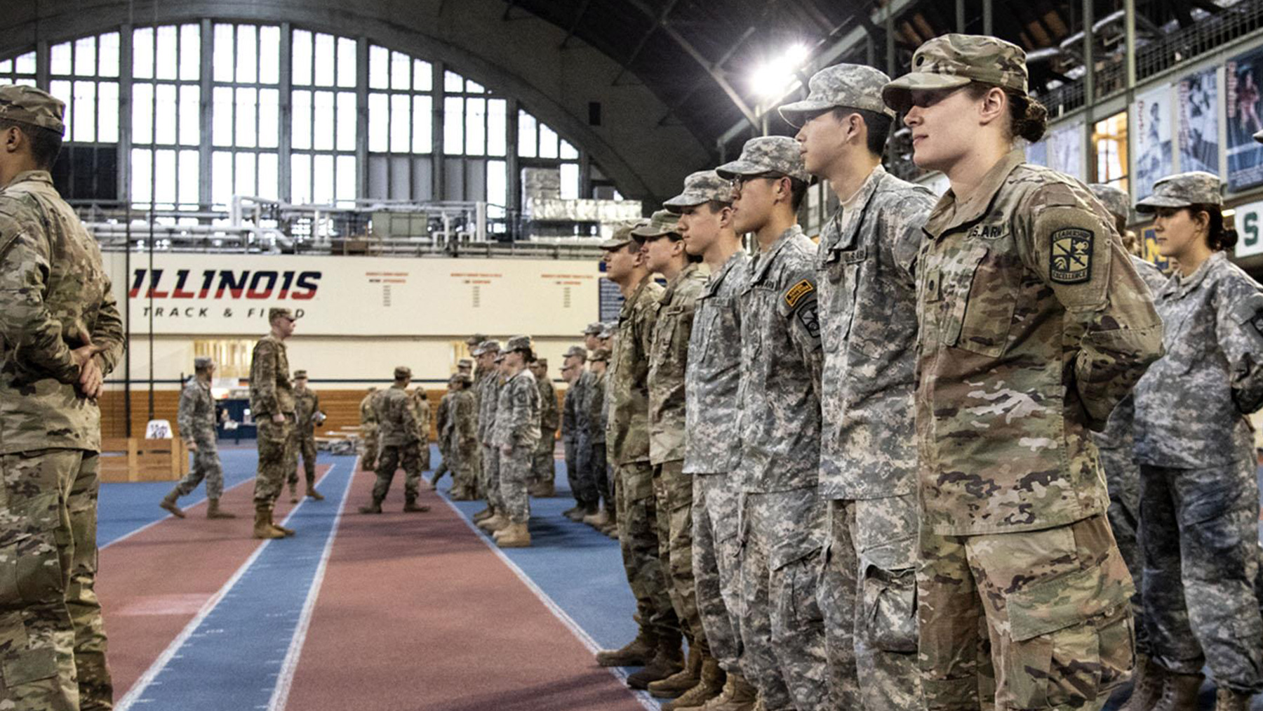 Molly Hein, foreground in front in a row of 'at ease' cadets, is a junior in Army ROTC cadet.