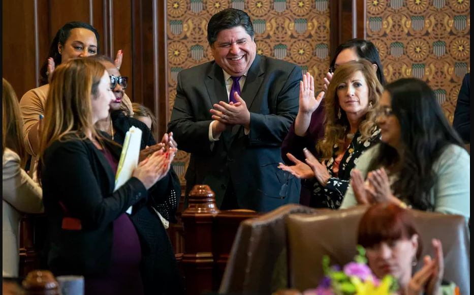 Gov. J.B. Pritzker cheers as Illinois Senate President John Cullerton, D-Chicago, gives his final remarks on the floor of the Illinois Senate on Sunday. Justin L. Fowler/The State Journal-Register via AP