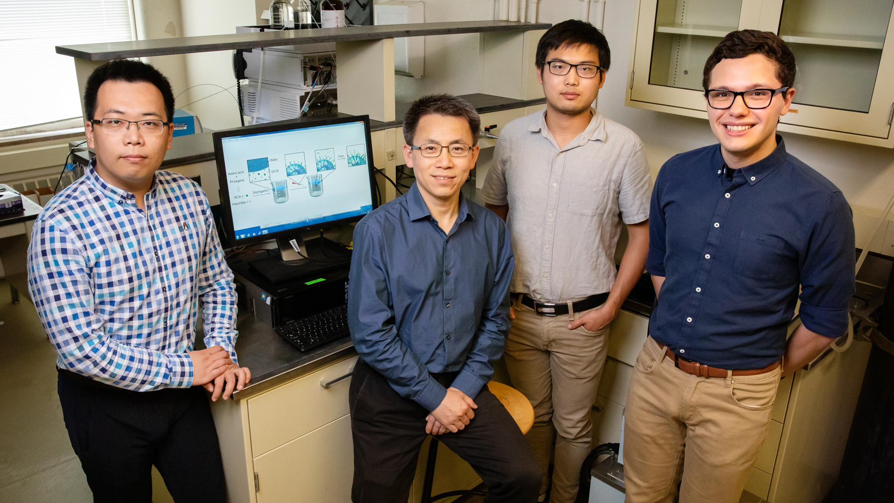 postdoctoral researcher Ziyuan Song, professor Jianjun Cheng and graduate students Tianrui Xue and Lazaro Pacheco. Photo by Brian Stauffer