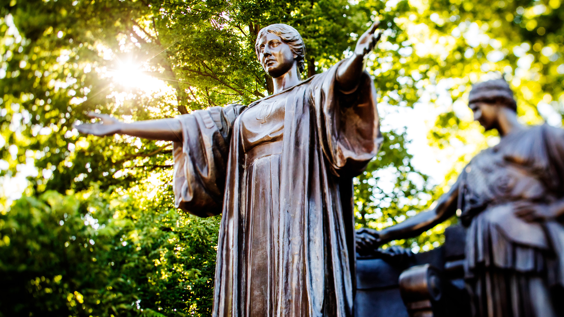 Alma Mater statue with arms wide and welcoming