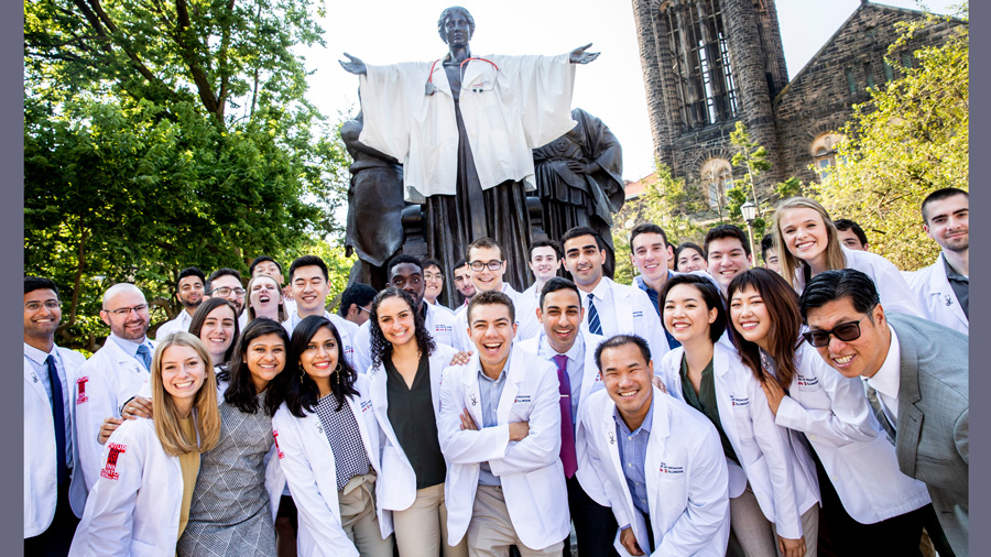 class photo with all students wearing their first 'white coat,' as is the Alma Mater statue in the background. Photo by Fred Zwicky