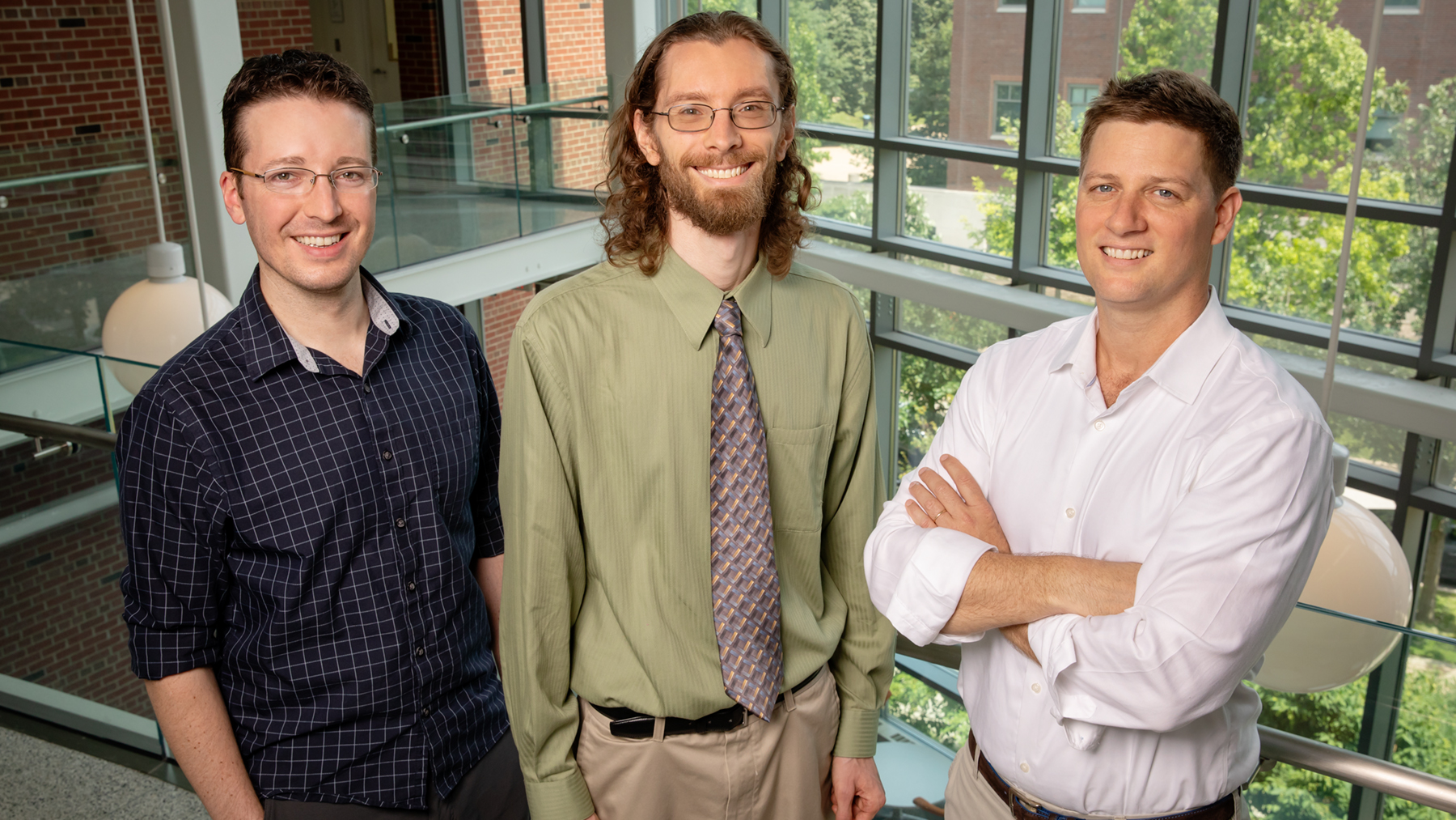 researchers Jeremy Guest, left, John Trimmer and Daniel Miller . Photo by Brian Stauffer