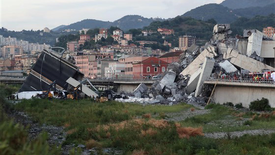 Rescuers inspect the rubble and wreckages by the Morandi motorway bridge after a section collapsed earlier in Genoa on Aug. 14, 2018.Photo by Valery Hache / AFP - Getty Images
