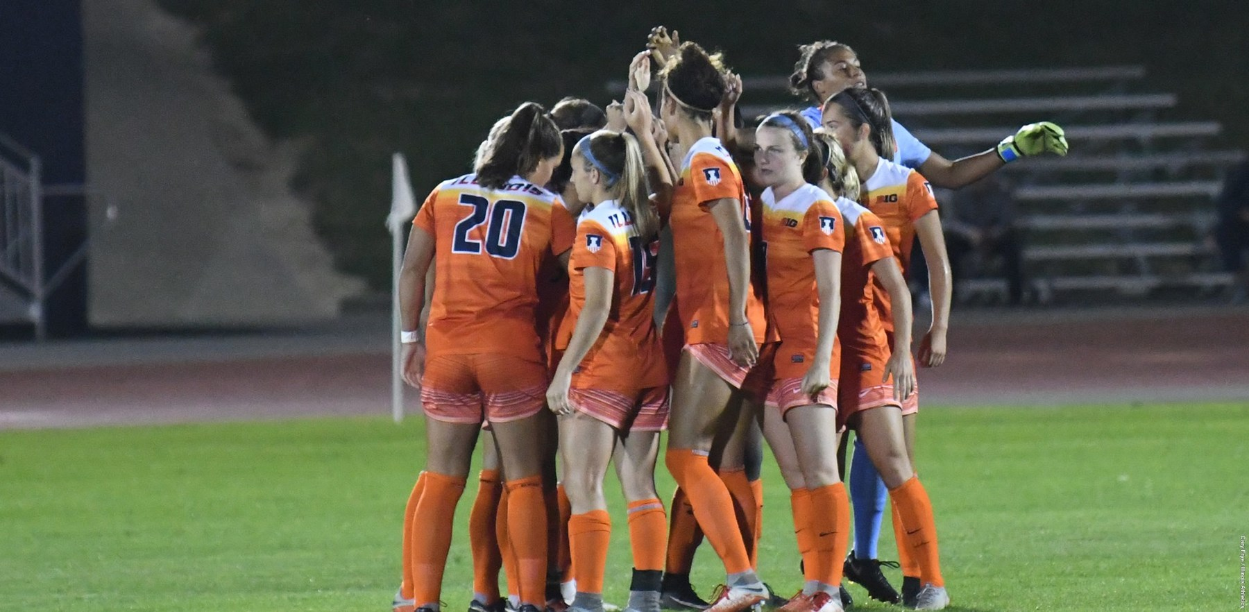 Illinois Soccer team members huddle on field during the 2018 season