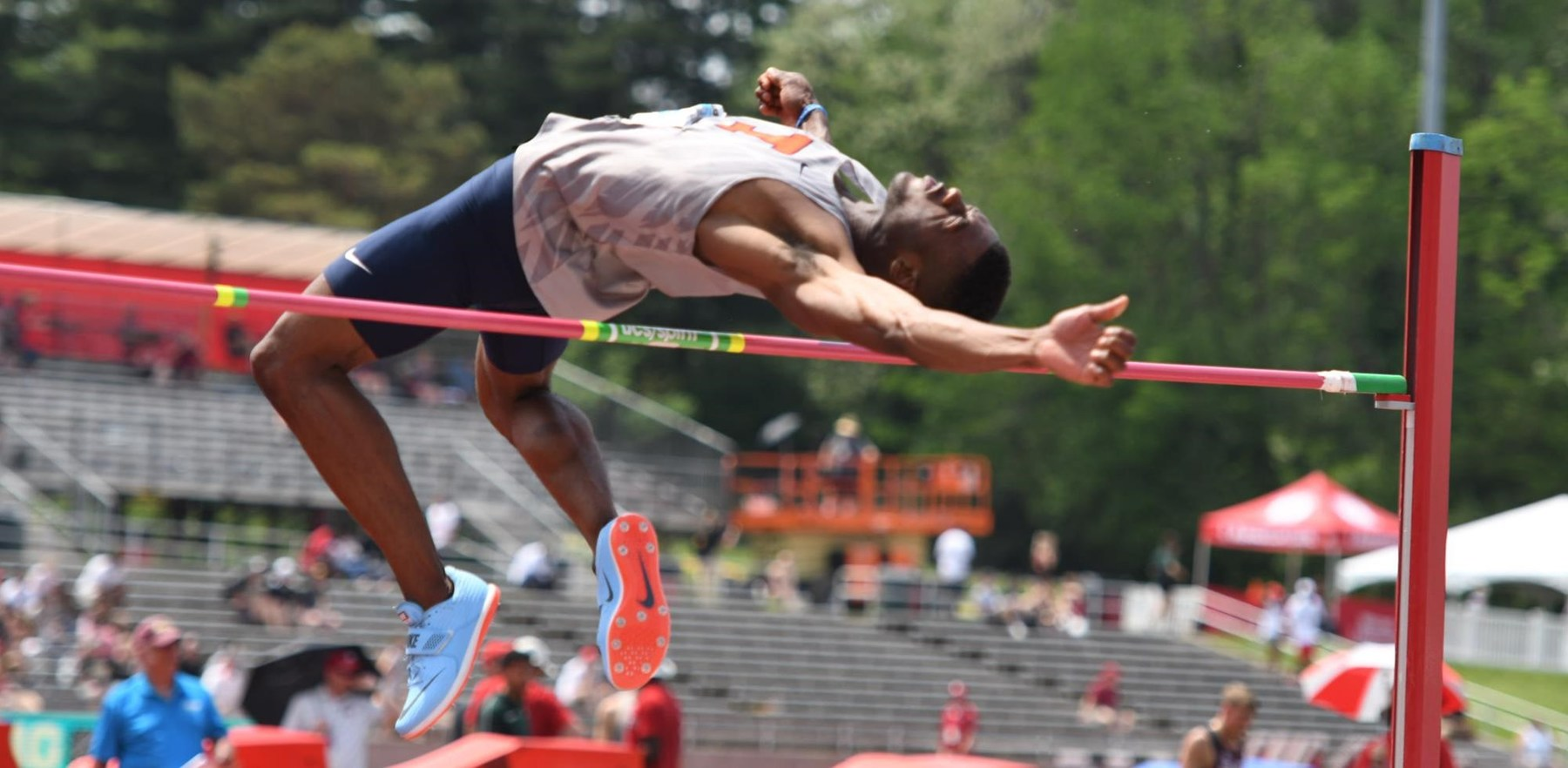 Jonathan Wells clears a high jump bar
