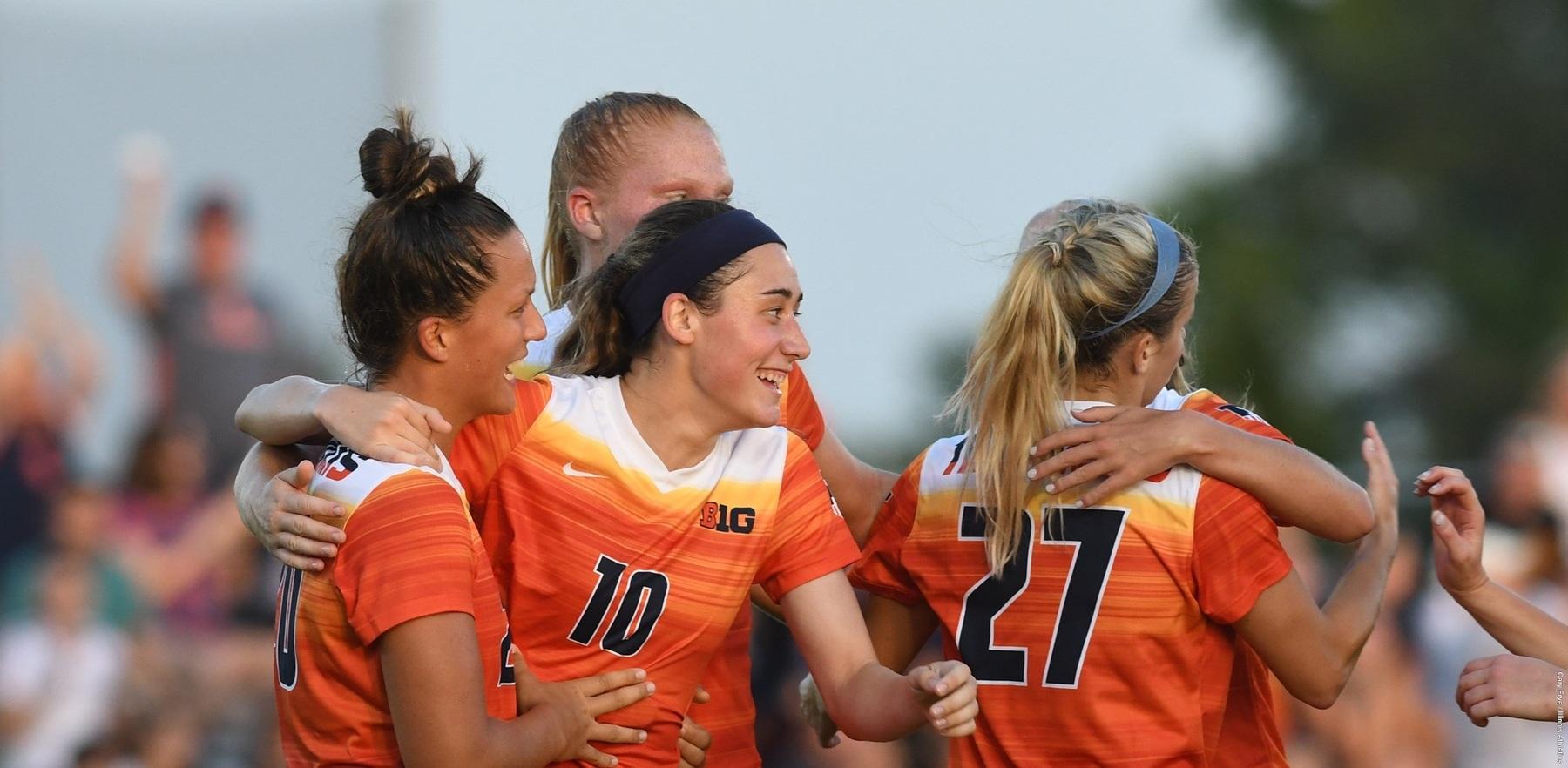 soccer team members celebrate during season-opening victory
