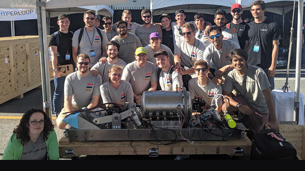 hyperloop team poses with a preliminary design