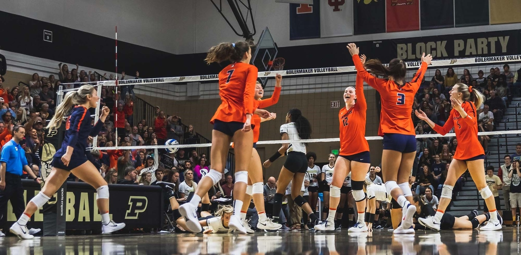 volleyball players celebrate on the court at Purdue