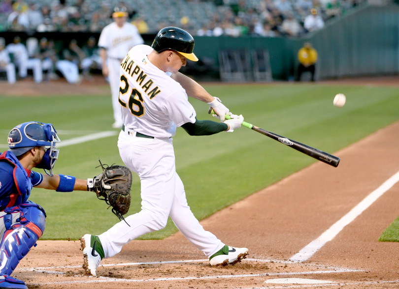Oakland Athletics batter Matt Chapman (26) hits a solo home run off Texas Rangers pitcher Lance Lynn in the first inning of their baseball game at the Oakland-Alameda County Coliseum in Oakland, Calif., on Tuesday, April 23, 2019. (Doug Duran/Bay Area News Group)