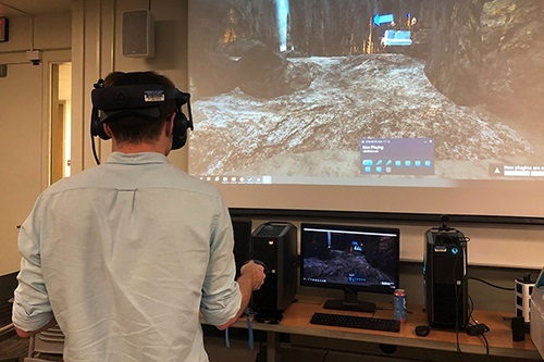 A student at a recent virtual reality open house tests how virtual reality equipment enhances educational experiences in the Department of Anthropology.
