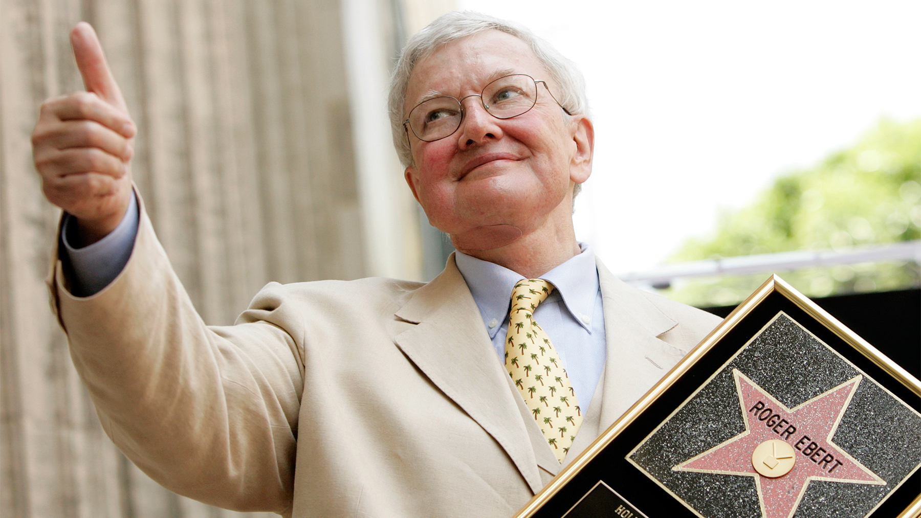 the late Rober Ebert giving his signature 'thumbs-up'