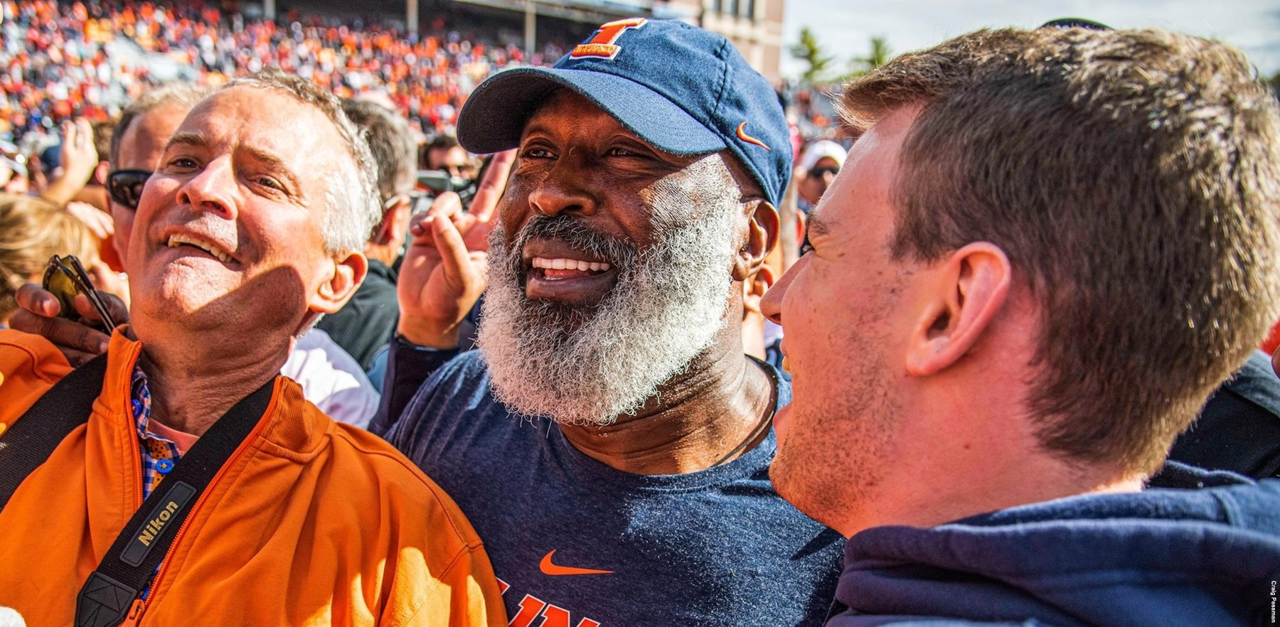 Coach Lovie Smith surrounded by fans following the win over Wisconsin on October 19, 2019