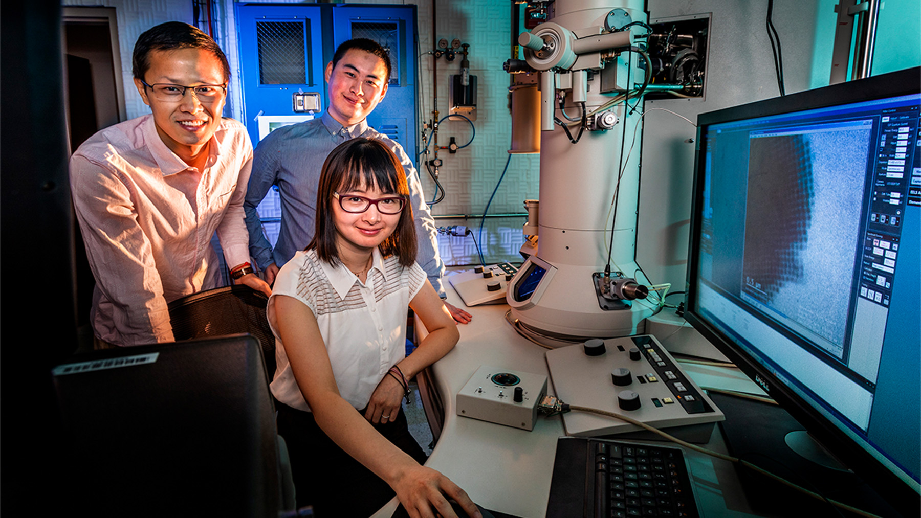 Professor Qian Chen, seated, and graduate students Binbin Luo, left, and Zihao Ou. Photo by Fred Zwicky