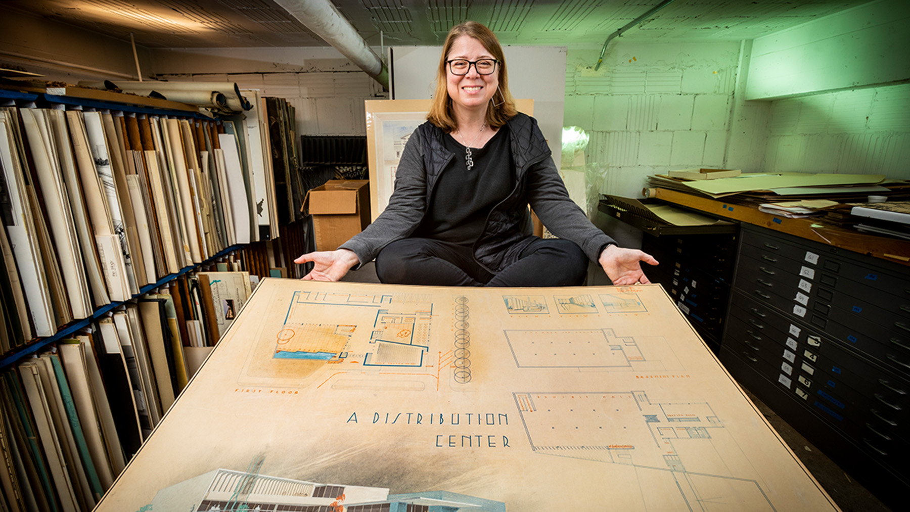 Architecture professor Marci Uihlein is leading a project to preserve and catalog a collection of University of Illinois architecture student drawings. The drawings are student design projects from 1890 to 1985, including this 1947 design for a distribution center.  Photo by Fred Zwicky