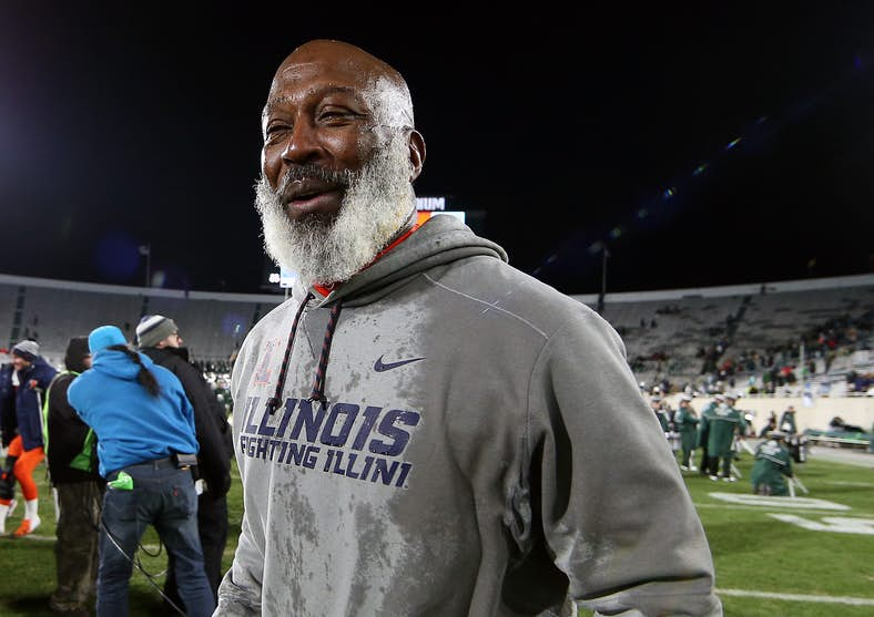 Coach Lovie Smith leaves the field after victory over MSU with large grin