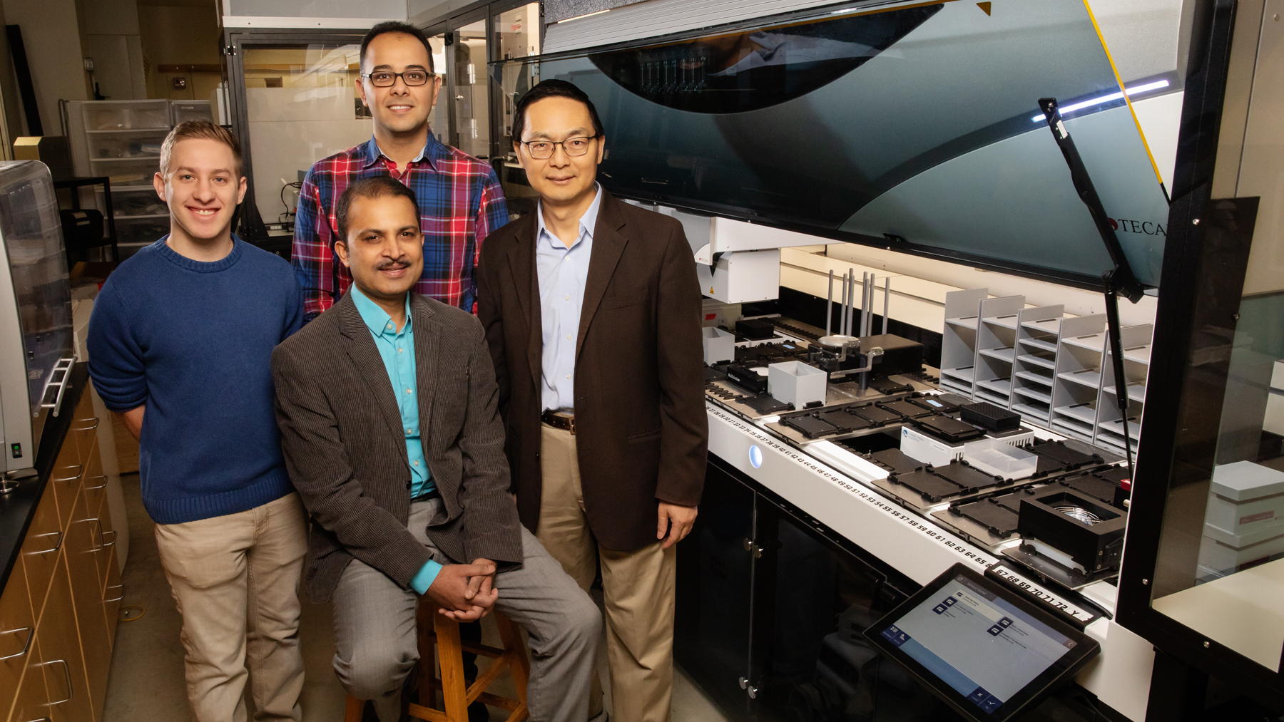 Scott Weisberg, professor Saurabh Sinha, Mohammad (Sam) Hamedi Rad and professor Huimin Zhao. Photo by Brian Stauffer