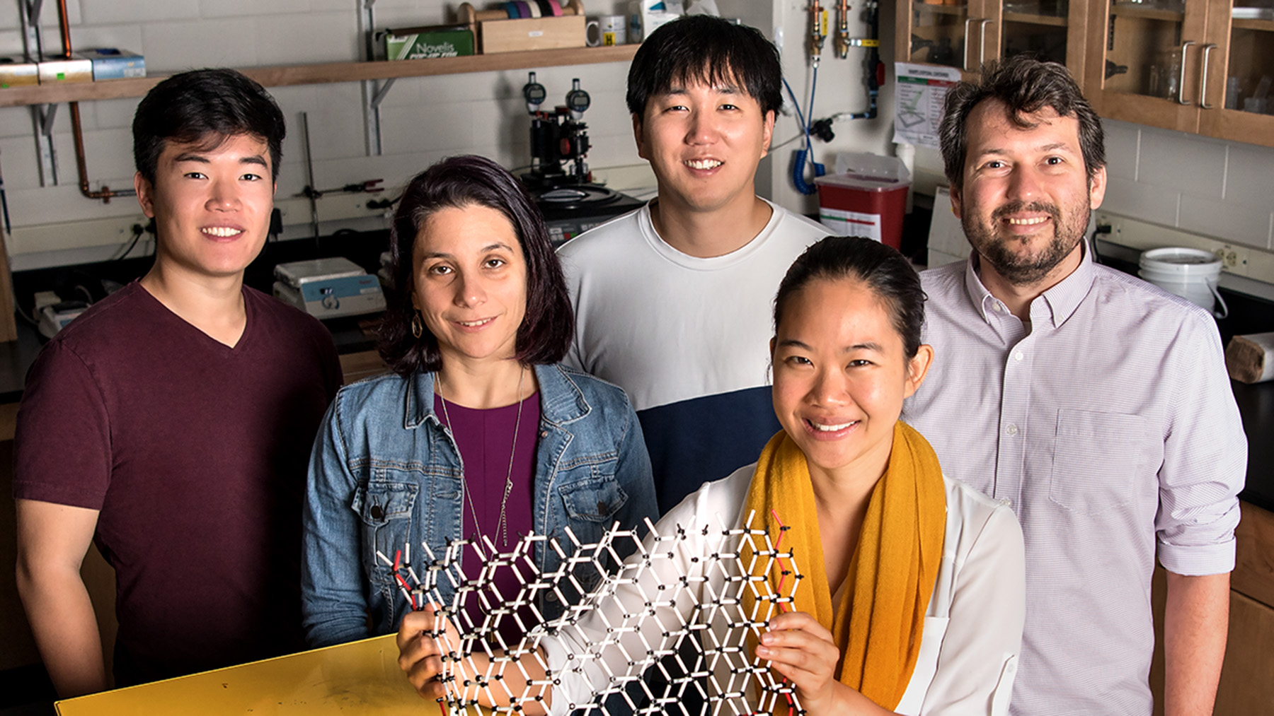 Graduate student Edmund Han, left, professor Elif Ertekin, graduate student Jaehyung Yu, professor Pinshane Y. Huang, front, and professor Arend M. van der Zande. Photo by Stephanie Adams