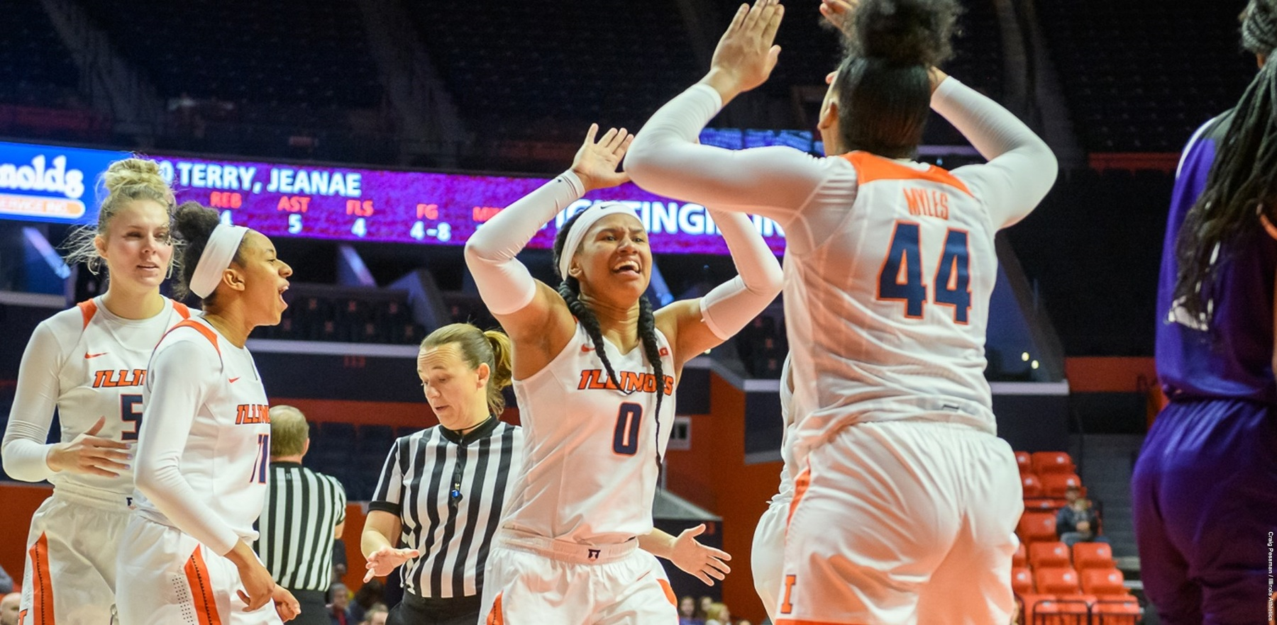 Illini players high five on the court