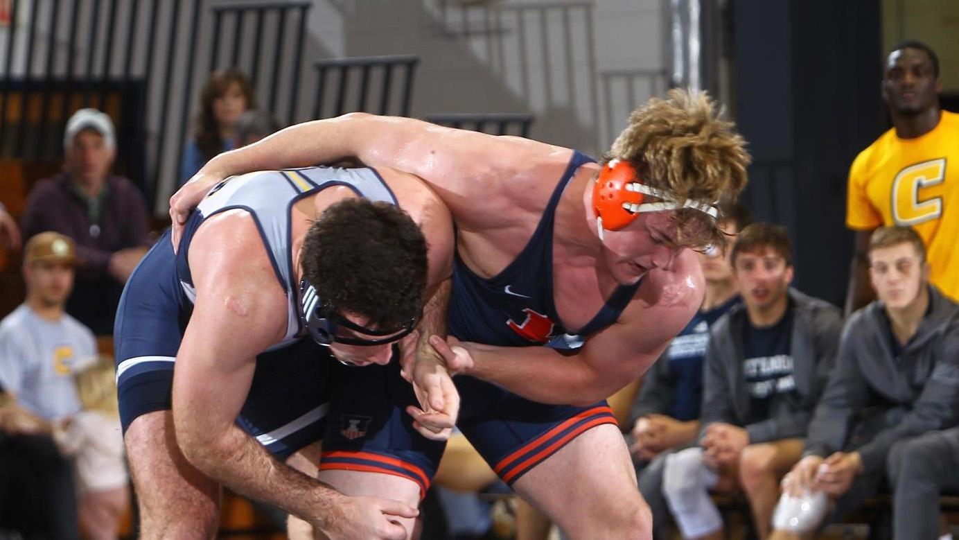 Freshman Luke Luffman wrestling in his match-winning bout