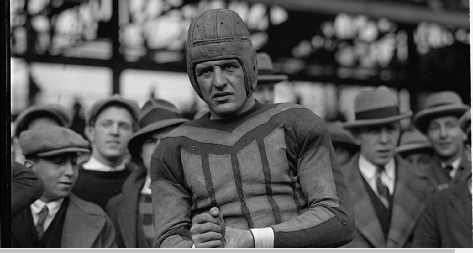 Red Grange in football uniform.