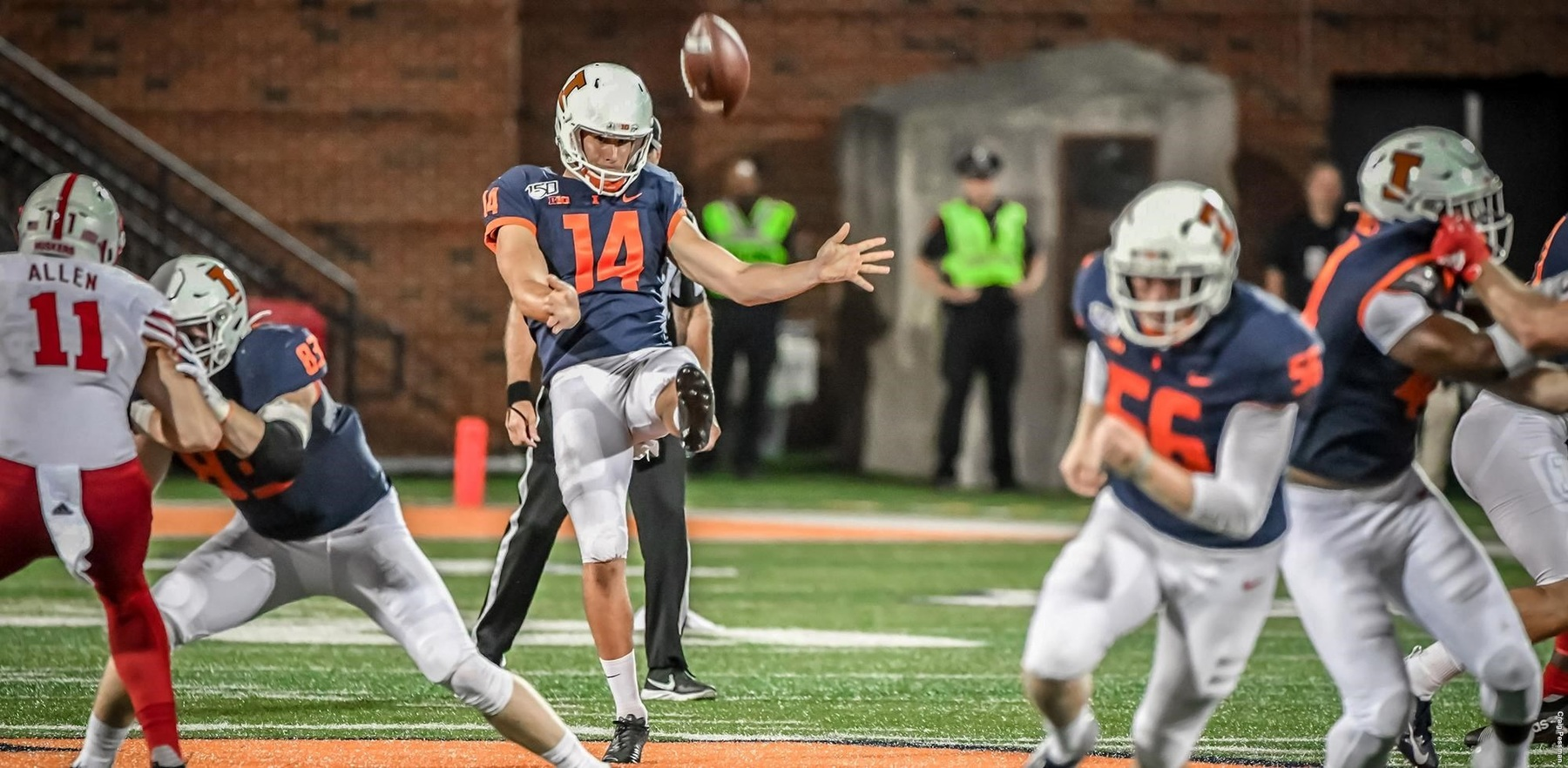 Hayes punts as other Illini defend him