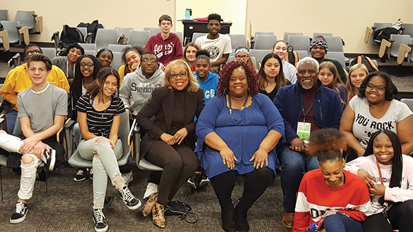 Rita Coburn Whack, shown with students, screened her film about Maya Angelou and discussed it with Urbana High School students. (Photo courtesy of the Alliance for Inclusion and Respect.)