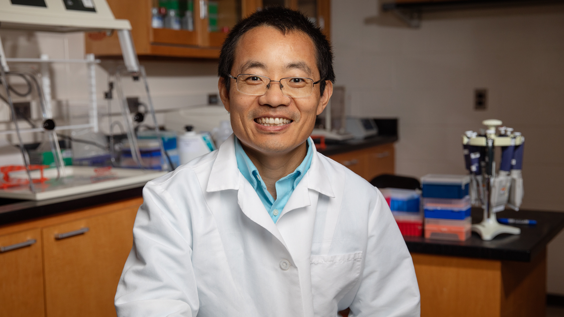U. of I. veterinary clinical medicine professor Dr. Leyi Wang led the team that detected bovine kobuvirus in the U.S.  Photo by Brian Stauffer