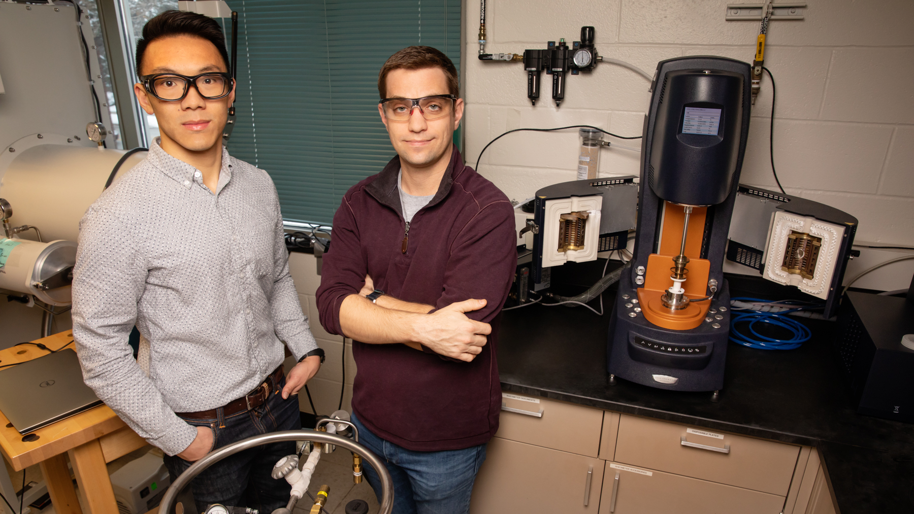 Materials science and engineering professor Christopher Evans, right, and graduate student Brian Jing have developed a solid battery electrolyte that is both self-healing and recyclable.  Photo by L. Brian Stauffer