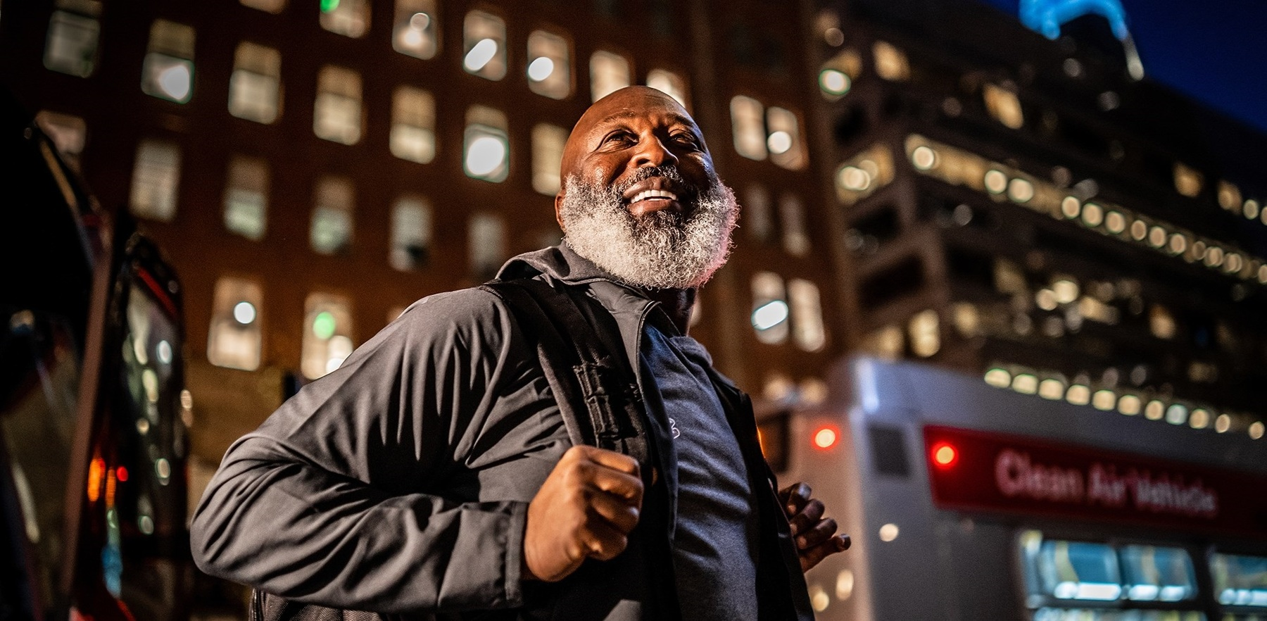 smiling Coach Lovie Smith disembarks from a bus in San Francisco