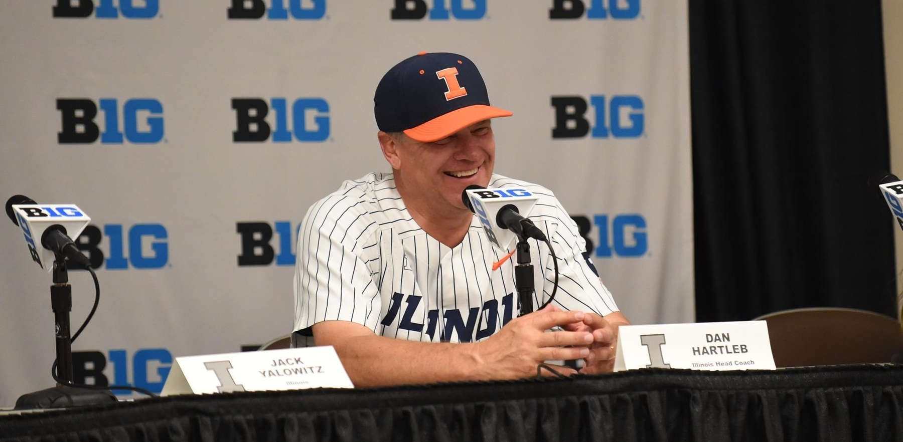 A smiling Dan Hartleb at a Big Ten press conference