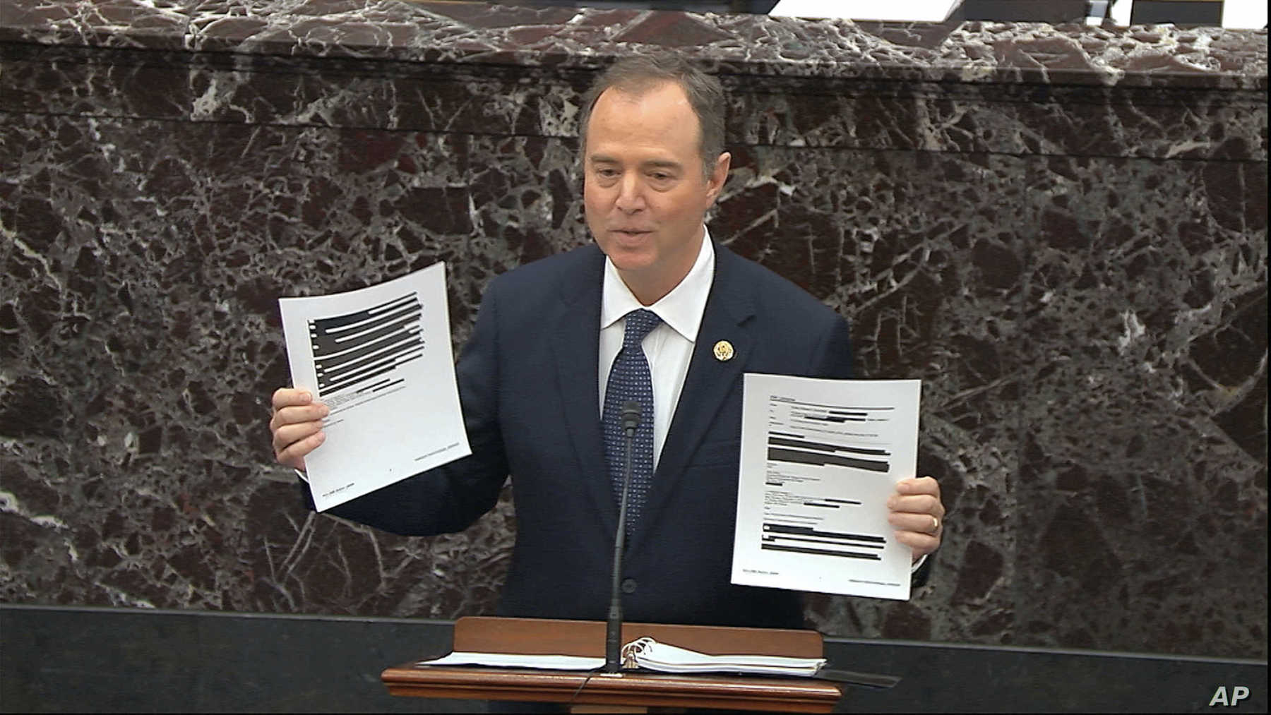 In this image from video, House impeachment manager Rep. Adam Schiff holds redacted documents as he speaks during the impeachment trial of President Donald Trump, in the Senate at the Capitol in Washington, Jan. 22, 2020. AP photo