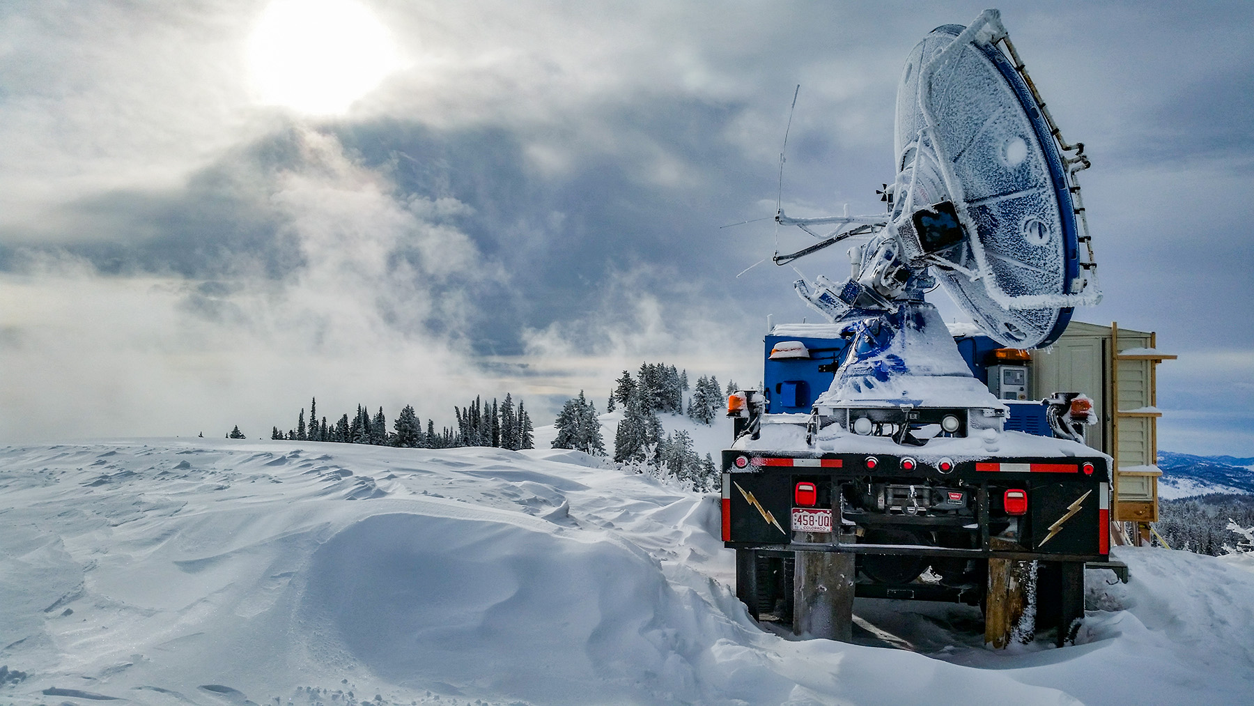 A special mountaintop radar called Doppler on Wheels measures precipitation in a new multi-institution cloud seeding study.  Photo by Joshua Aikins
