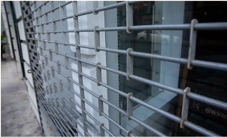 closed gates at a retail store. Photograph: Adela Loconte/Rex/Shutterstock
