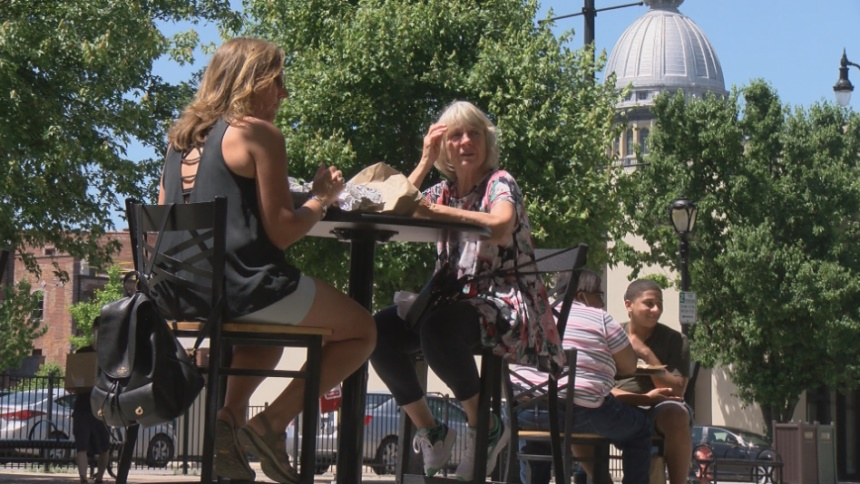 People dine on a patio as restaurants partially reopen