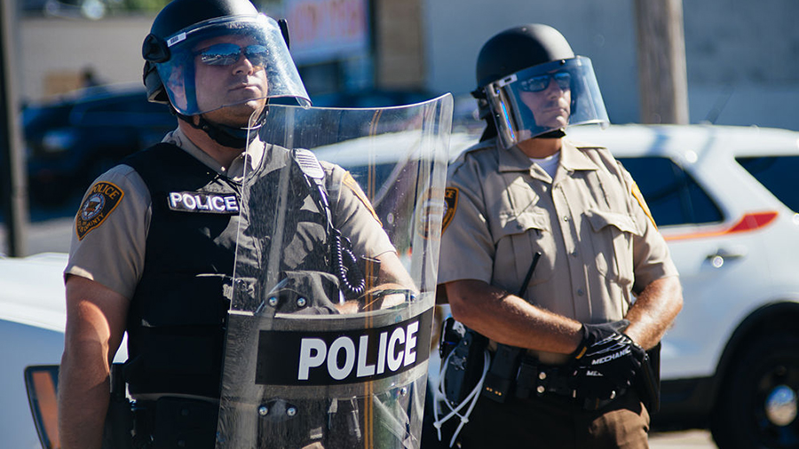 police in riot gear at a protest in Ferguson, Missouri
