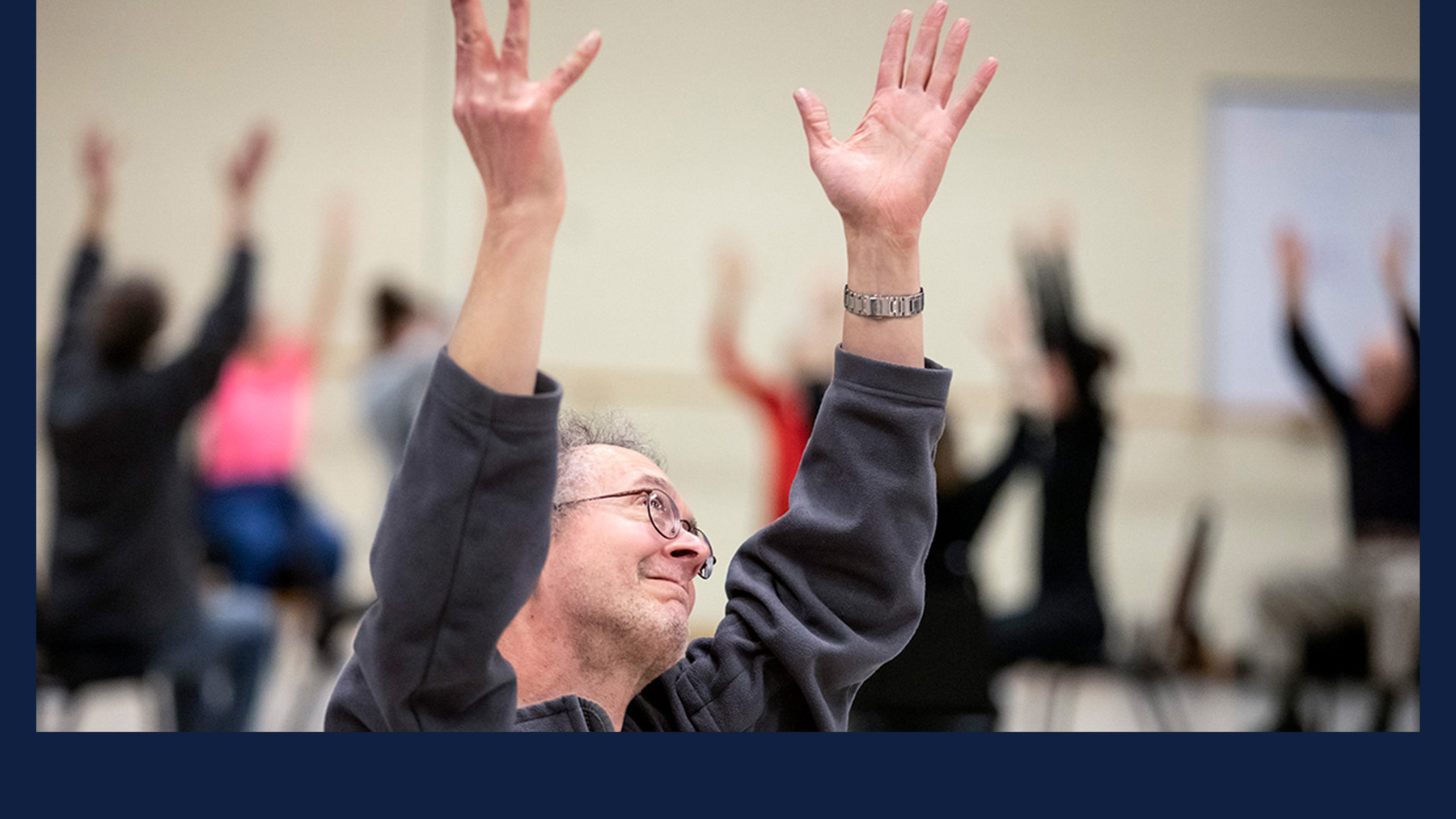 Gary Stitt, 61, stretches his arms to the sky as people gather for a Dance for People with Parkinson's class at Krannert Center for the Performing Arts. All photos by Fred Zwicky