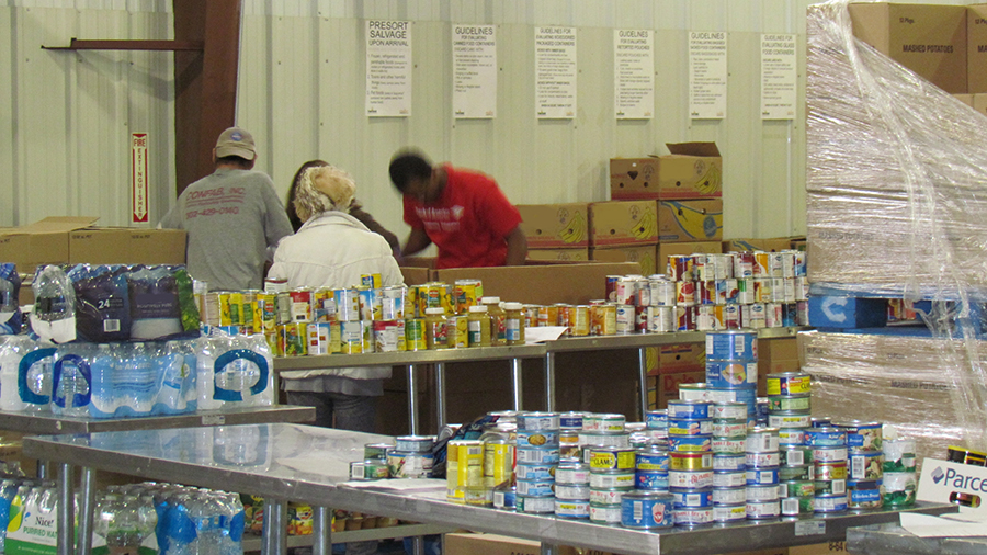 volunteers sort food donations at a food bank in Delaware. Wiki Commons photo