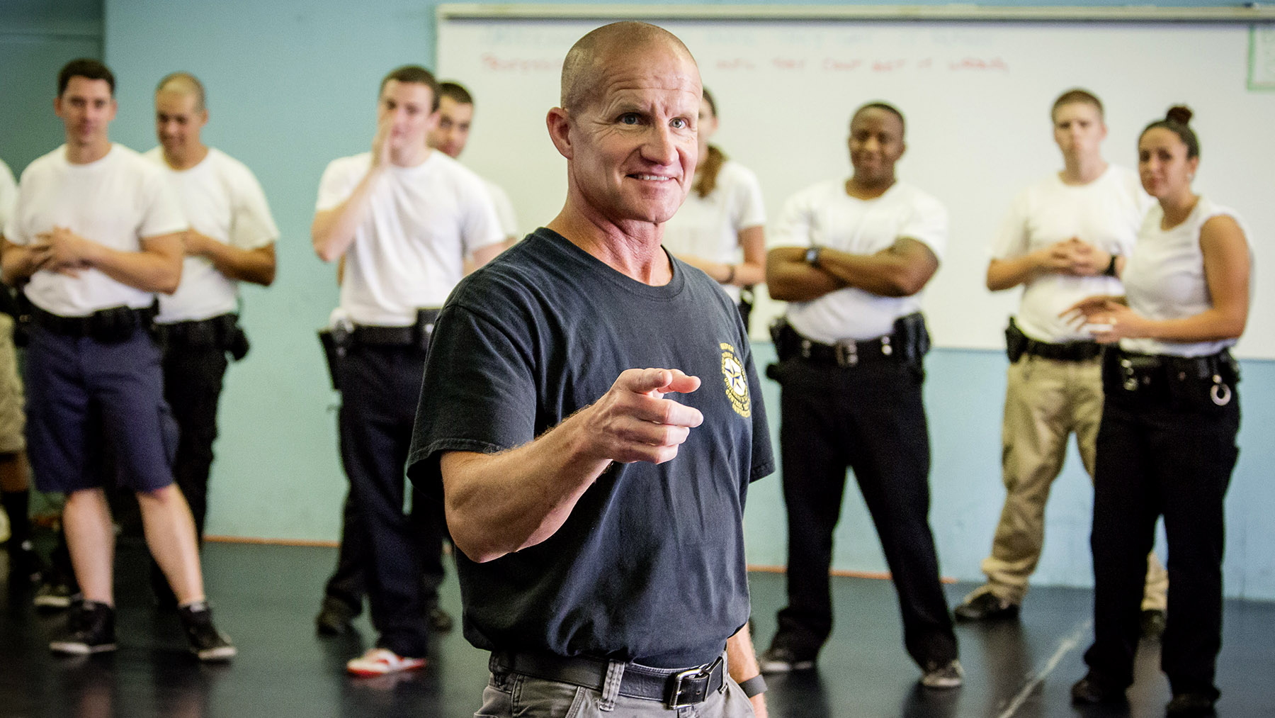 Police Training Institute director Dr. Mike Schlosser leads a class with young officers. Photo by L. B. Stauffer