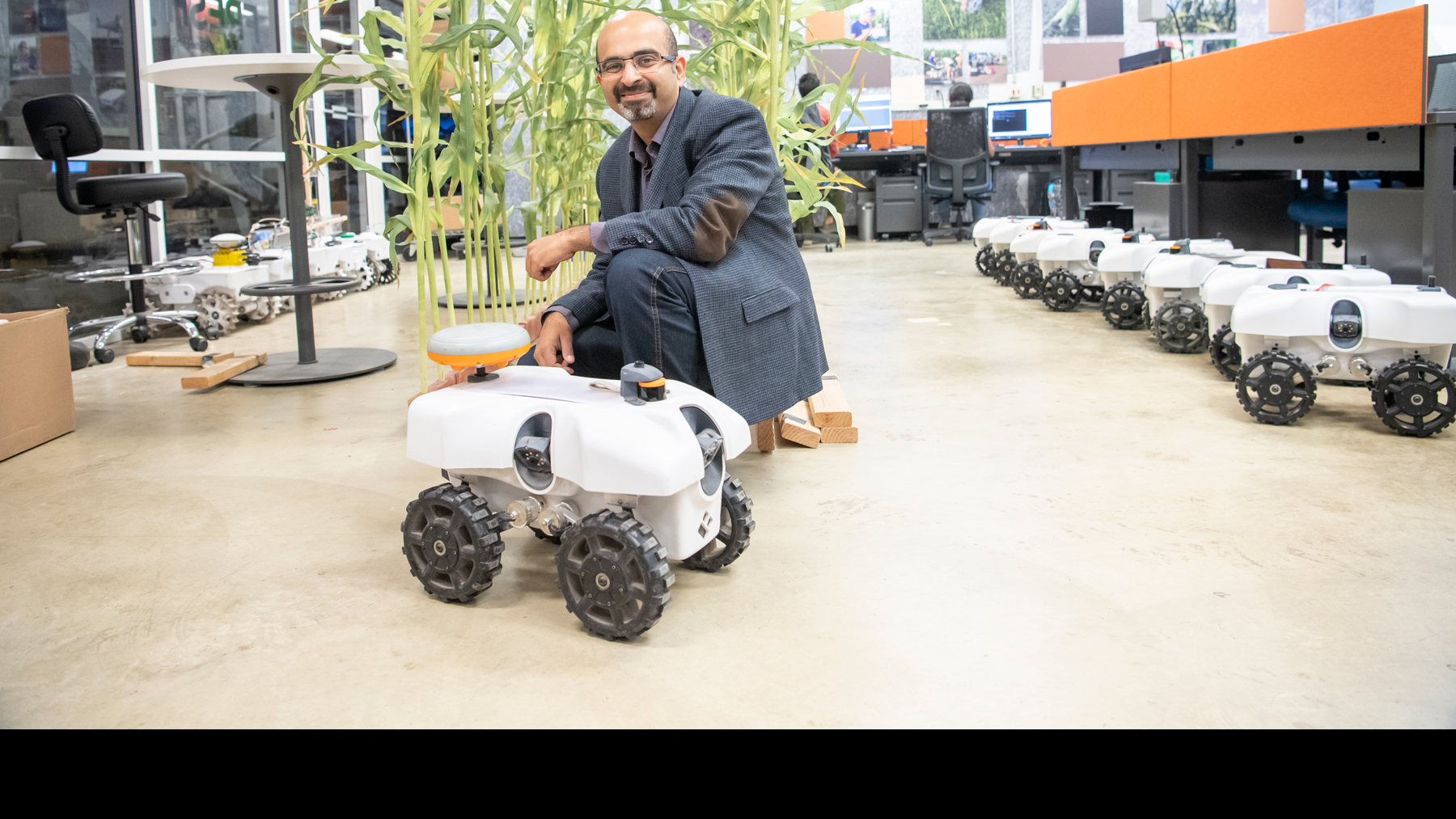 Professor Girish Chowdhary with the TerraSentia robot.