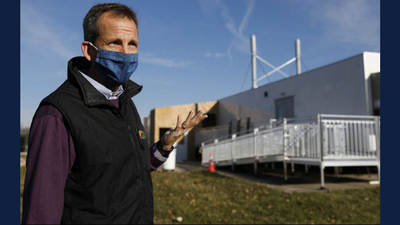Harley Johnson, associate dean of research at Grainger College of Engineering, stands outside a mobile unit where up to 10,000 saliva samples per day are processed. Johnson oversaw the team that built and designed the mobile unit. (Jose M. Osorio / Chicago Tribune)