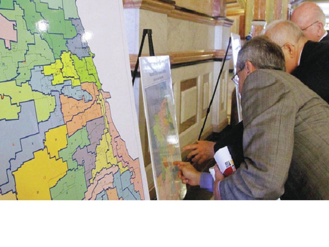 Pols review congressional maps. Photo by SAGA Communications
